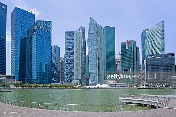 Highrise office blocks and skyscrapers in the Central Area / Central Business District of Singapore seen from the Marina Bay