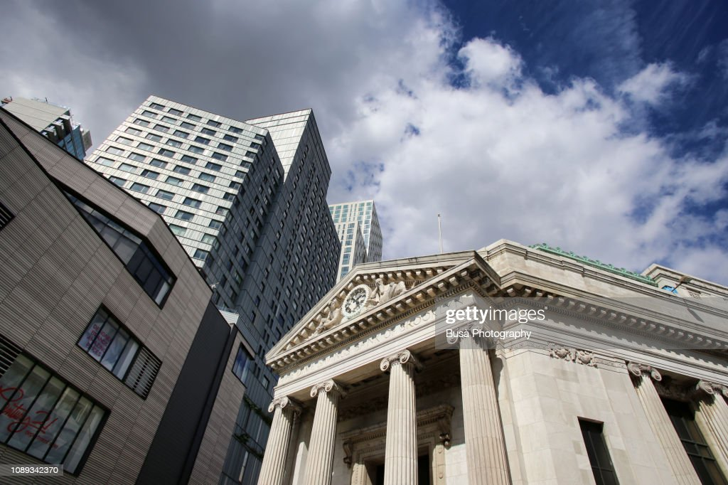 Highrise office tower and neoclassical building at Albee Square by the Fulton Street Mall in Fort Greene, Brooklyn, New York City : Stock Photo