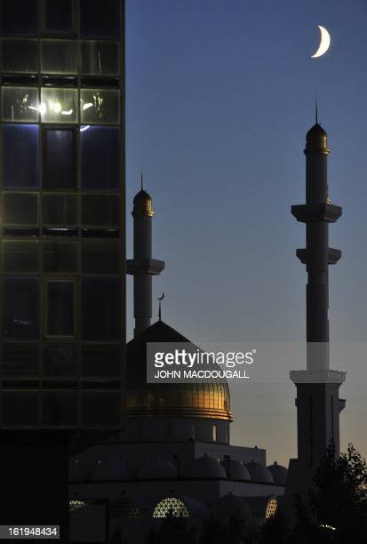 A highrise partially hides the NurAstana mosque and Islamic centre in Kazakhstan's capital Astana October 12 2010 The Islamic Center was built in...