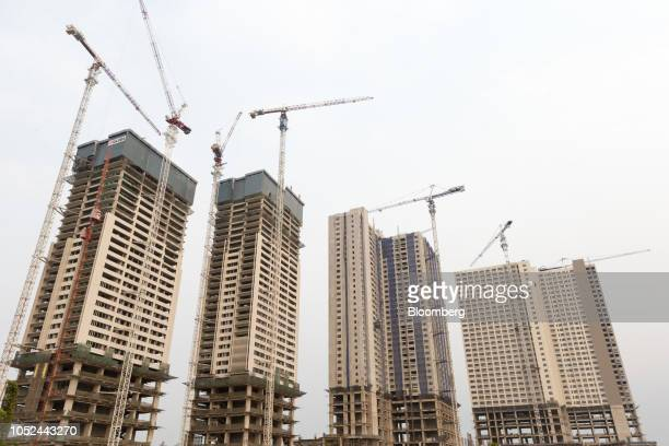 Highrise tower blocks stand at the under construction Meikarta project developed by Lippo Group in Bekasi Regency West Java Province Indonesia on...