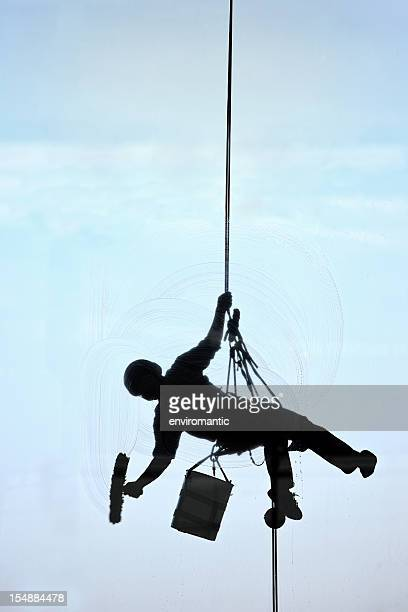 high-rise window cleaner. - window cleaning stock photos and pictures