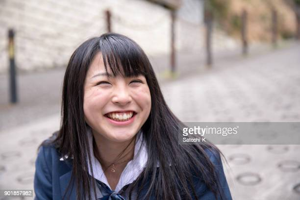 highs school girl making full of smile - female high school student stock pictures, royalty-free photos & images