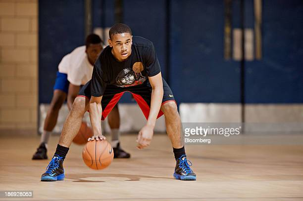Highschool junior Edward Morrow runs drills and plays basketball during an open gym at Simeon High School in Chicago Illinois US on Wednesday May 15...