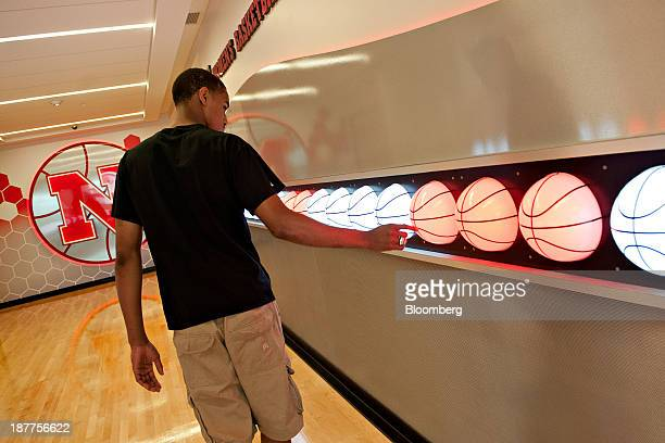 Highschool junior Edward Morrow walks through the lobby of the basketball training facility during an alumni tour of the University of Nebraska in...