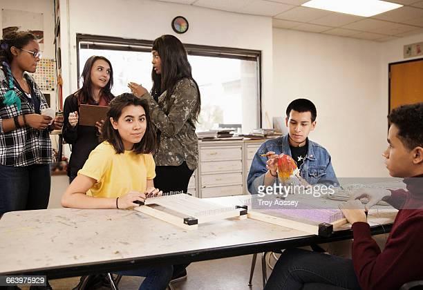 Highschool students in classroom.