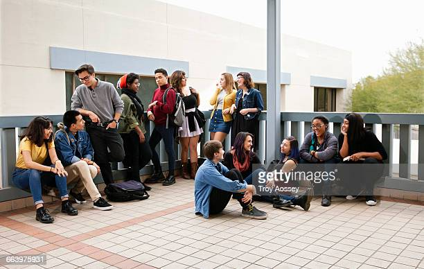 Highschool students solcializing at school.