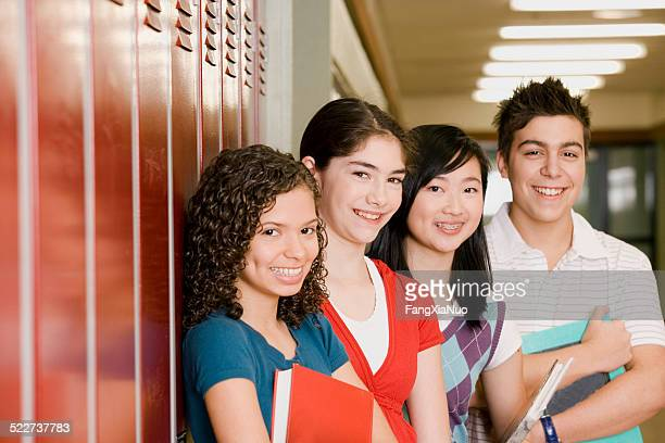 High-school students standing in front of lockers