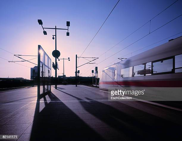 ice high-speed train at train station at dawn. - high speed train stock pictures, royalty-free photos & images