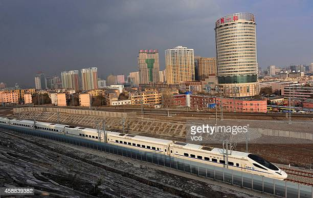 A CRH highspeed train runs across Urumqi city during its test run on November 11 2014 in Urumqi Xinjiang Uyghur Autonomous Region of China The...