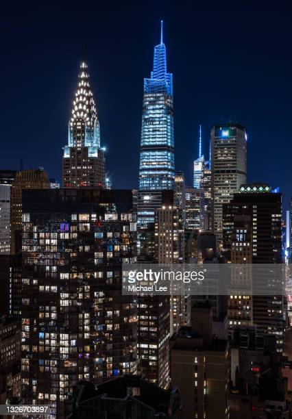 hight angle night view of chrysler building and one vanderbilt in new york - manhattan new york city stock pictures, royalty-free photos & images