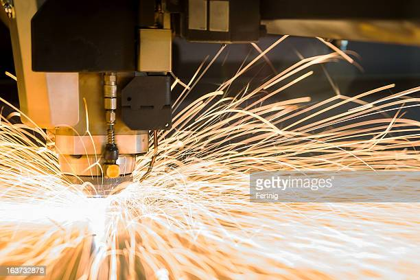 High-tech metal CNC, cutting laser tool in use.