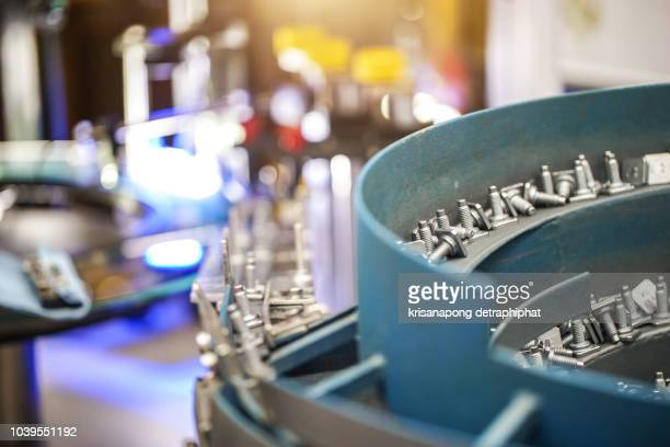 high-tech nut production machine,machine,nut production machine,technology - spare part stock pictures, royalty-free photos & images