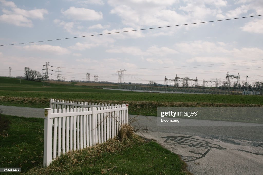 High-tension power lines stand on a farm near the Exelon Corp. Three Mile Island nuclear power plant in the neighborhood of Londonderry Township near Middletown, Pennsylvania, U.S., on Wednesday, April 11, 2018. On Sept. 30, Exelon Corp. plans to take Three Mile Island offline because it is no longer profitable. Across the U.S., Nuclear plants are having trouble staying competitive in an era of cheap natural gas, a product of the shale boom. Photographer: Michelle Gustafson/Bloomberg via Getty Images