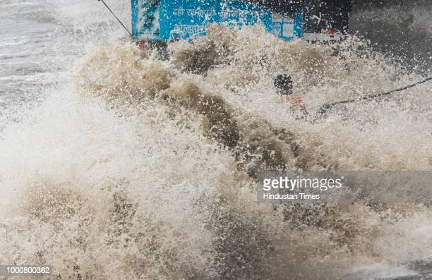 Hightide waves hit the closed food stall at Dadar chowpatty on July 15 2018 in Mumbai India On Sunday Mumbai experienced the highest tide of the...