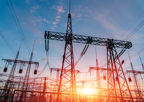 High-voltage power lines. Electricity distribution station. high voltage electric transmission tower. Distribution electric substation with power lines and transformers 1135081245