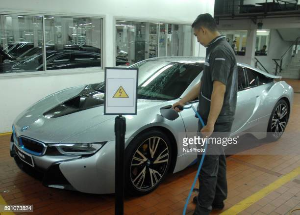 BMW highvoltage technician carries battery charging on the car at BMW i servicing servicing ilectric car and plugin hybrid BMW Jakarta December...
