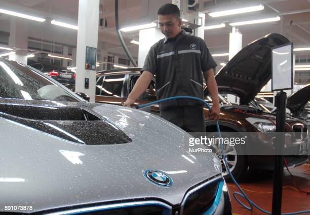 BMW highvoltage technician carries battery charging on the car at BMW i servicing electric car and plugin hybrid BMW Jakarta December 122017 BMW i...