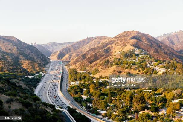 highway 405 and surrounding hills in los angeles, california - city of los angeles stock pictures, royalty-free photos & images