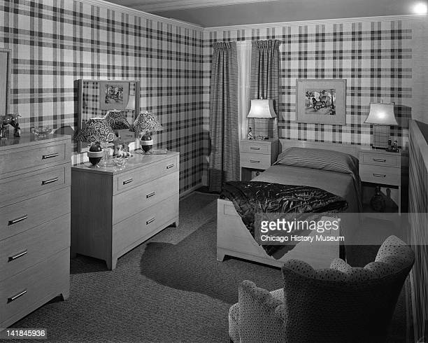 Highway 42 Section of Marshall Field Company furniture department Boys bedroom with plaid wallpaper Chicago Illinois February 15 1943
