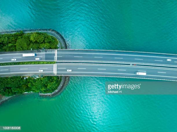 highway across the ocean - emerald green stock pictures, royalty-free photos & images