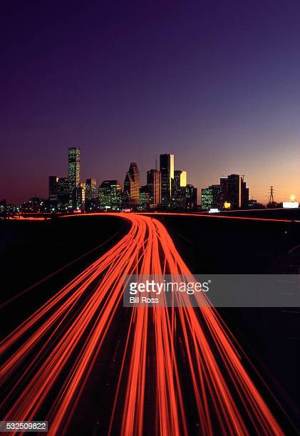 highway and houston skyline - tail light stock pictures, royalty-free photos & images