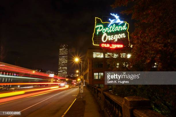 highway and neon sign at night, portland, oregon, usa - portland oregon stock pictures, royalty-free photos & images