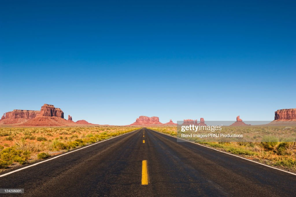 Highway and rock formations in desert : Stock Photo