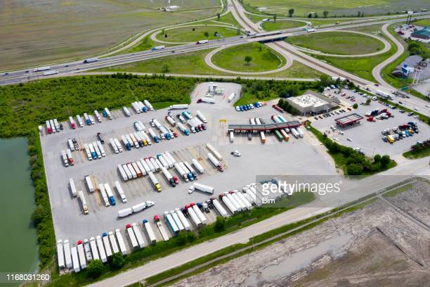 highway and truck stop full of semi trucks, aerial view, usa - food distribution stock pictures, royalty-free photos & images