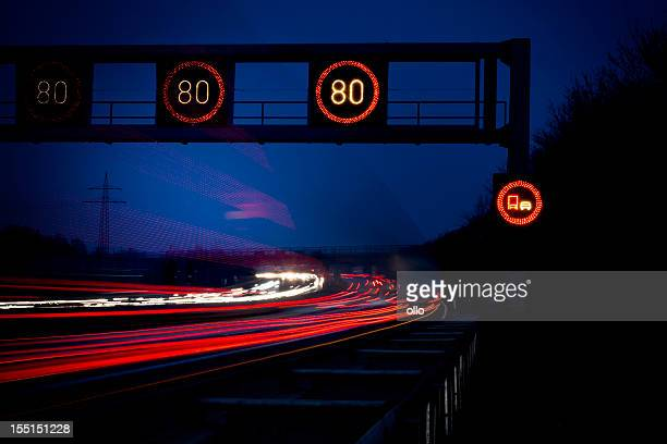 highway at dusk, long exposure - speed limit sign stock photos and pictures