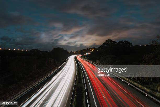 highway at night - long exposure stock pictures, royalty-free photos & images