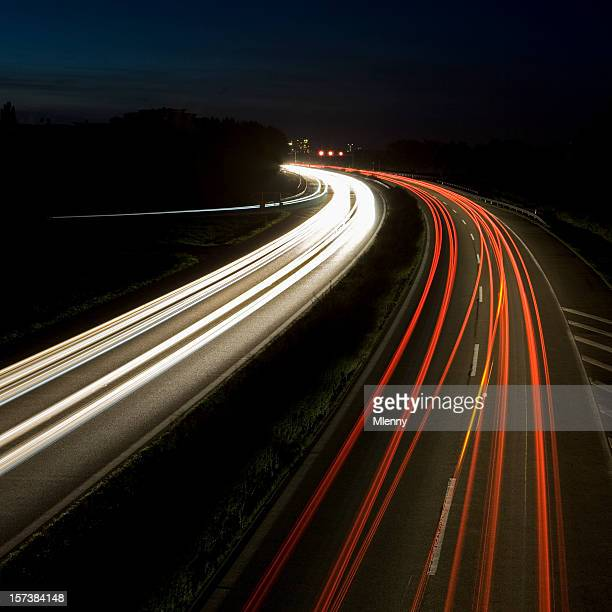 highway at nightime - mlenny stock pictures, royalty-free photos & images