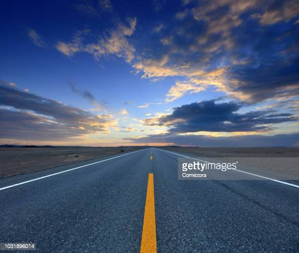 highway at sunrise day - thoroughfare stock photos and pictures