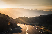 Highway at sunrise, going into Death Valley National Park