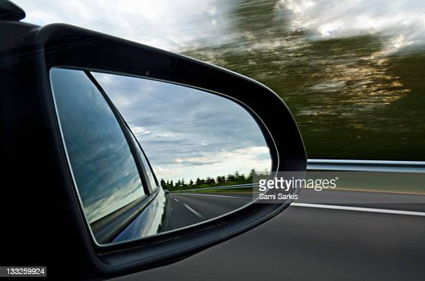 Highway at sunset, reflected by side-view mirror