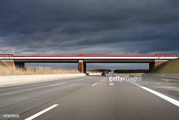 Highway / Autobahn, bridge - dark clouds