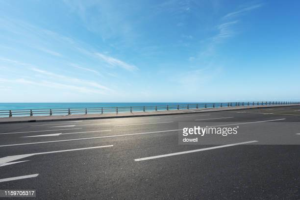 highway beside beach - next to stock pictures, royalty-free photos & images