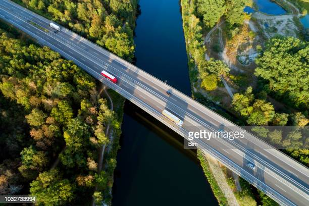 highway bridge, aerial view - trucking stock pictures, royalty-free photos & images