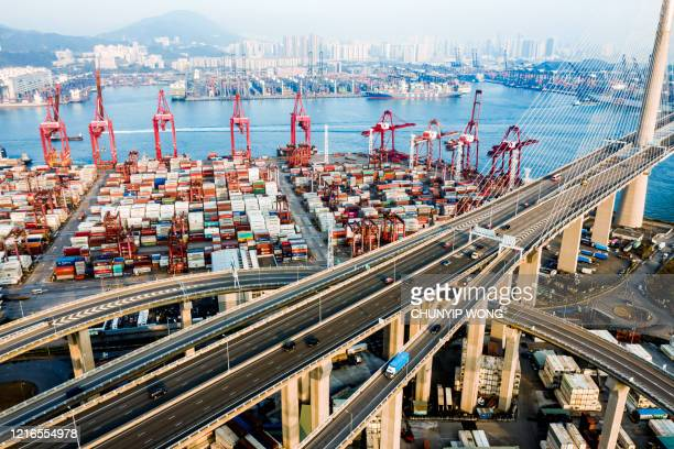 highway bridge in hong kong and container cargo freight ship - national landmark stock pictures, royalty-free photos & images