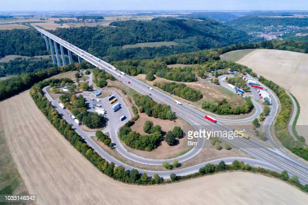 Highway bridge, truck stop and rest area, aerial view