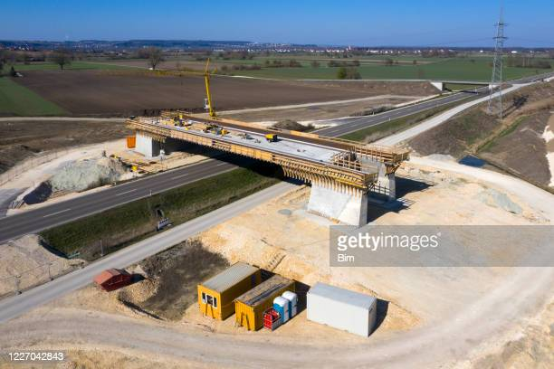 highway bridge under construction, aerial view - bridge built structure stock pictures, royalty-free photos & images