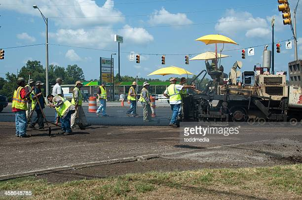highway construction - asphalt paving stock photos and pictures