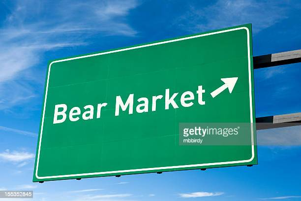 highway directional sign for bear market - bear market stock pictures, royalty-free photos & images