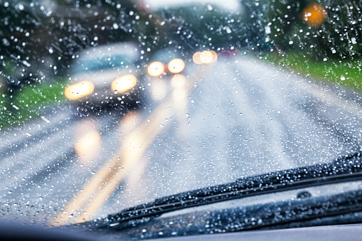 Highway Driver POV Through Raindrop Car Windshield During Rain Storm 613216216