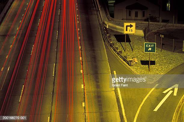 highway exit, elevated view (blurred motion) - exit sign stock pictures, royalty-free photos & images