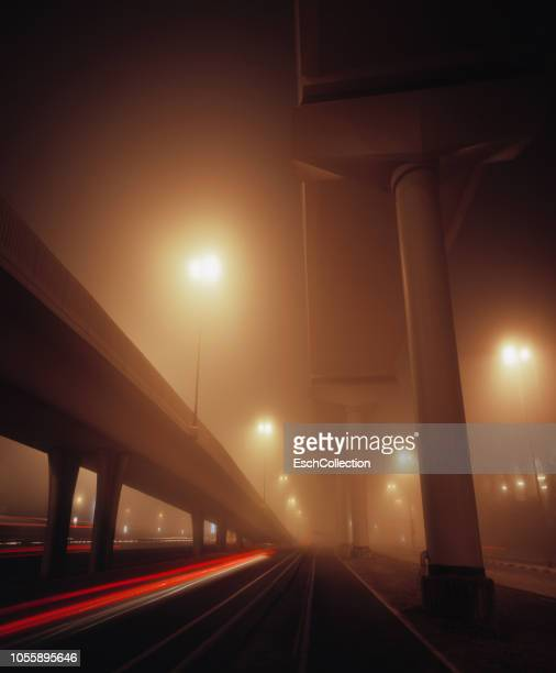 Highway exit shrouded in mist in Dubai at dawn