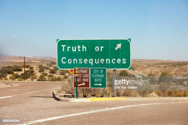 highway exit sign for truth of consequences nm - honesty stock pictures, royalty-free photos & images