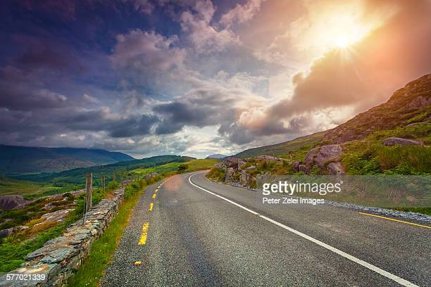 Highway in Ireland at sunset