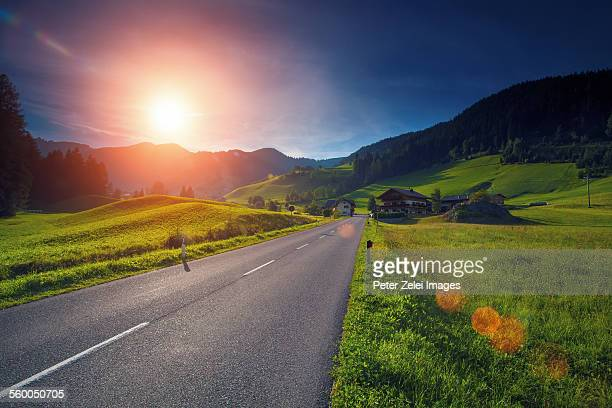 Highway in the mountains at sunset