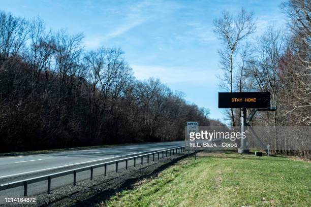 A highway information display says STAY HOME on a mostly empty Interstate 87 on Sunday afternoon The highway was mostly empty on the same day that...