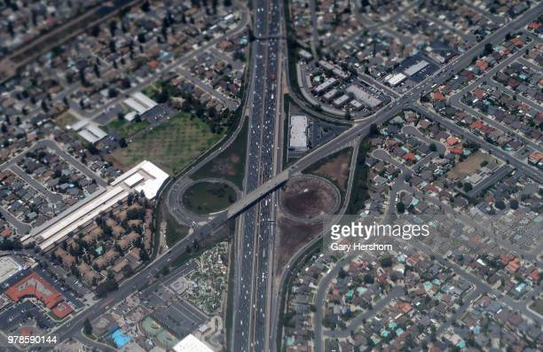 A highway interchange in Orange County California is seen through the exhaust of an airplane on approach to John Wayne Airport on June 15 2018 in...